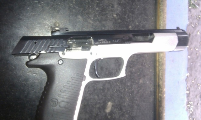 Picture of CZ 122 Sport, part black and silver, with the slider open